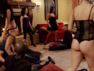 Interracial couples get into a big orgy