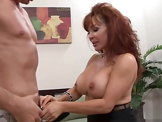 Redhead MILF wants his raging boner