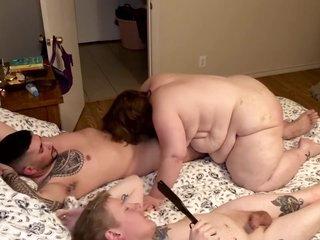 BBW MILF Charli gets a spanking during BDSM threesome.