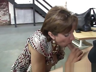 Milf Lady Sonia gives young mechanic handjob and blowjob in exchange