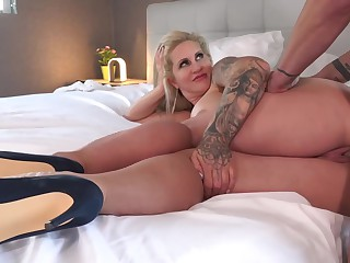 Busty and curvy blonde milf babe Ryan Conner is sucking her boy off like a true slut