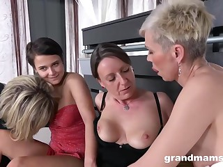 Kinky grannies are having a lesbian group sex and using a strap- on to spice it up