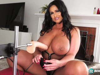 Voluptuous brunette with big tits, Kailani Kai is using a fucking machine to drill her tight ass