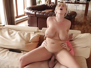 Busty blonde woman has a huge smile on her face, because she is about to get fucked