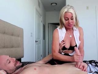 Blonde MILF wanking a long cock