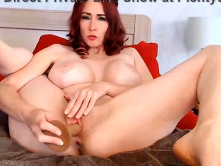 Redhead milf with Huge Silicone boobs